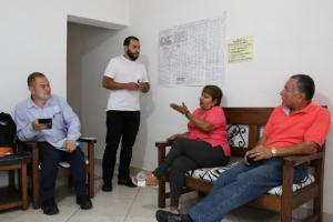 Members of a trust network in Medellin discuss a loan through the city's Bancuadra program.